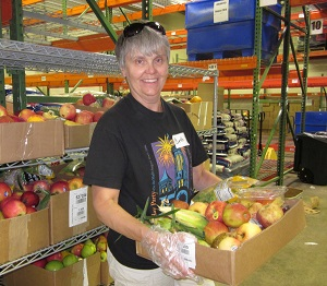 Picture of Manna Food Center volunteer holding box