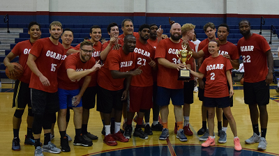 Image of GCAAR basketball team with trophy
